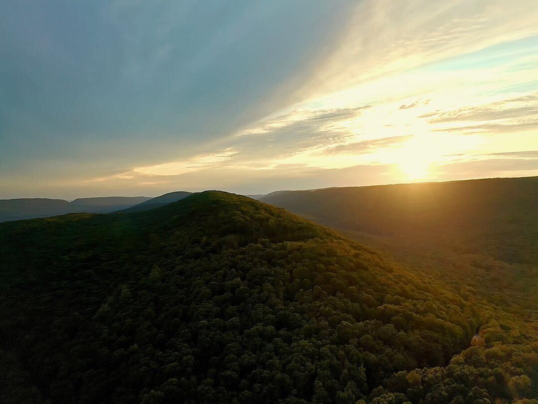 Landscape photo overlooking the rolling ridges of the Kittatinny Ridge at sunset.